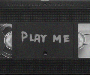 play me, black and white, and text image