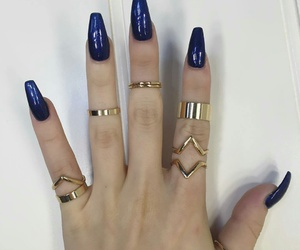 Gold Rings Coffin Nails And Navy Blue Image