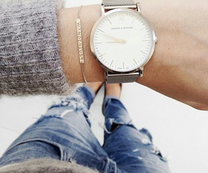 bracelet, jeans, and sweater image