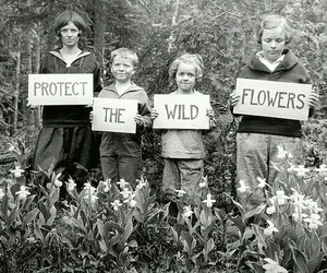 flowers, children, and black and white image