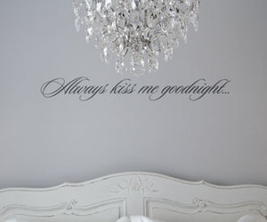 bed, calligraphy, and chandelier image