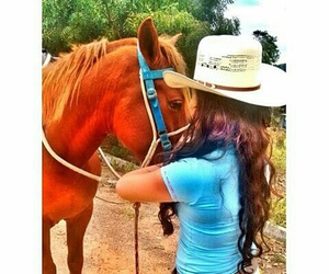 Cowgirl and horse image