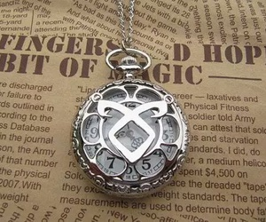 runes, book, and necklace image