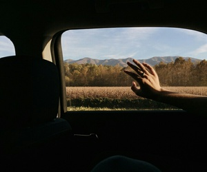 car and hand image