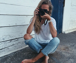 camera, jeans, and white top image