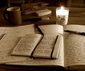 writing, candle, and book image