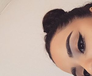 bun, eyebrows, and eyeliner image