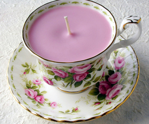 candle, flowers, and cup image