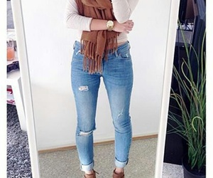 gold watch, brown scarf, and straight brown hair image