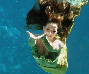 mermaids and ocean image