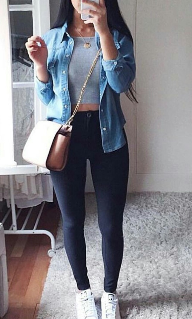 gold necklaces, white sneakers, and black high waisted jeans image