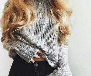 brown lips, black high waisted jeans, and long curled blonde hair image