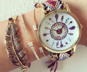 bracelets, watch, and feather image