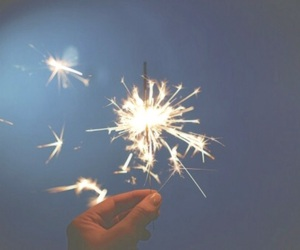 fireworks, hand, and stars image