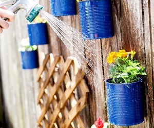 recycled tin cans, tin can decorations, and decorations image