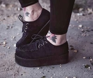 'shoes', 'tattoo', and 'black' image