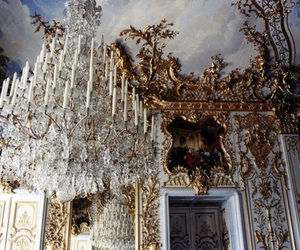 chandelier, interior, and gold image