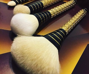 Brushes, gold, and glam image