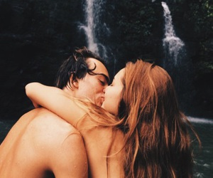 couple, kissing, and waterfall image
