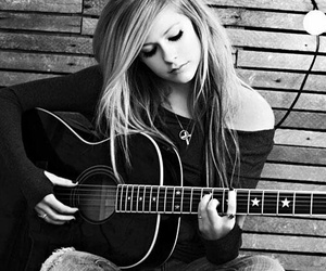 Avril Lavigne, guitar, and music image