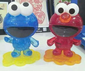 elmo, cookie monster, and crystal puzzel image