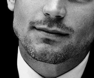 black and white, cheek bones, and suit and tie image