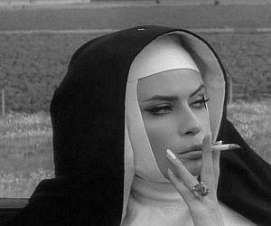 nun, black and white, and smoke image