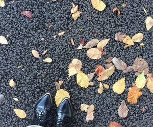 asphalt, headphones, and toes image