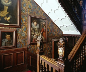 bannister, paintings, and stairs image