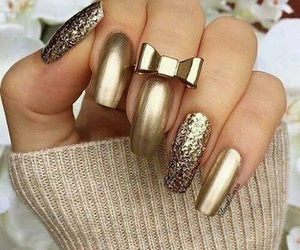 gold, nails, and bow image