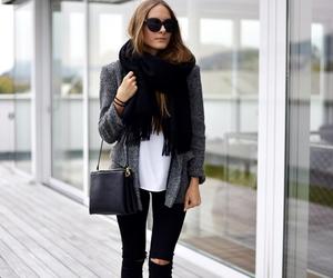 black boots, black cardigan, and black jacket image