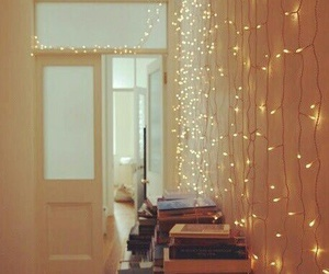 books, lamp, and garlands image