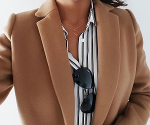 black sunglasses, blazer, and jewelry image