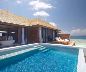 house, pool, and ocean image
