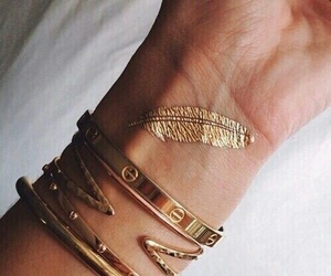 gold, tattoo, and bracelet image