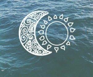 sun, moon, and sea image