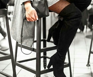 black leather purse, black knee high boots, and grey knit sweater image