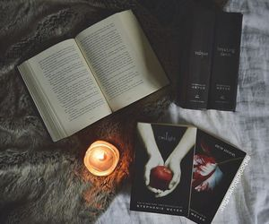 books, candle, and twilight image