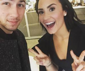 demi lovato, nick jonas, and selfie image