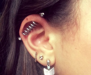 earring, spiral, and industrial piercing image