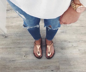 ripped jeans, birkenstock, and rosegold image