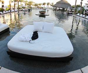bed, luxury, and pool image