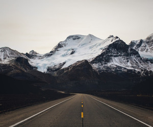 mountains, road, and snow image