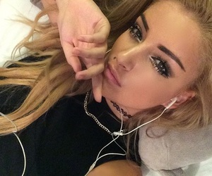 blonde, earbuds, and icon image