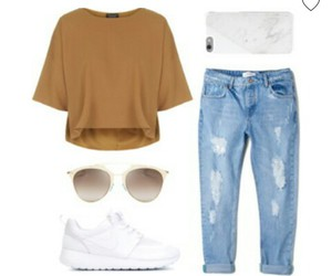 white clutch, ripped blue jeans, and white nike shoes image