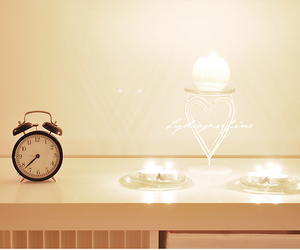 alarm clock, candles, and heart image