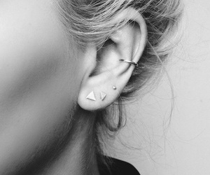 black and white, earing, and piercing image