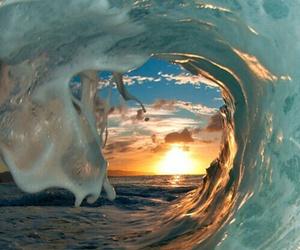 waves, sun, and sea image