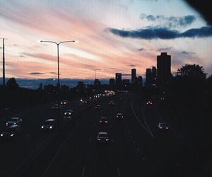 city, sky, and car image