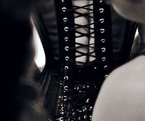black, leather, and corselet image